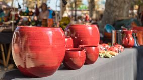 Ceramic pots for sale at artisan market in Ile rousse. L`Ile Rousse, Corsica - 30th September 2018. Hand made ceramic pots and jugs are displayed for sale at an stock photo