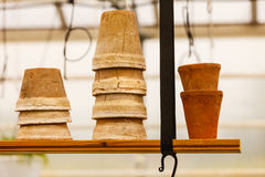 Ceramic pots on shelf hung from ceiling Royalty Free Stock Photo
