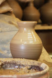 Ceramic pottery making proccess. Handmade clue pottery. Potter hands Stock Photography