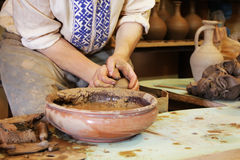 Ceramic pottery making proccess. Handmade clue pottery. Potter hands Stock Image