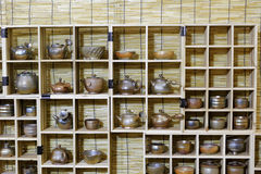 Ceramic products on the wooden frame Stock Photos