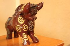 A ceramic Pucara Bull statues. A ceramic Pucara Bull Statue made to be placed on the roof for prosperity in Ollantaytambo, Peru stock image