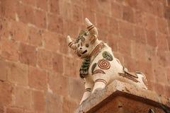 A ceramic Pucara Bull statues. A ceramic Pucara Bull Statue placed on a pillar at a house in Raqchi, Peru stock photography