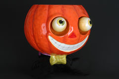 Ceramic pumpkin with bow tie. Ceramic halloween jack o lantern with a bow tie and a big smile Stock Photo