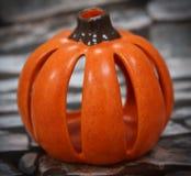 Ceramic Pumpkin with a Slate Brick Background Stock Photo