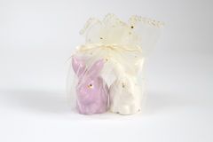 Ceramic rabbit in net bag. For isolate royalty free stock photo