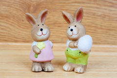 Ceramic rabbits with egg an a flower Royalty Free Stock Images