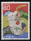 Ceramic rat. RUSSIA KALININGRAD, 18 MARCH 2016: stamp printed by Japan, shows a ceramic rat, circa 2008 royalty free illustration