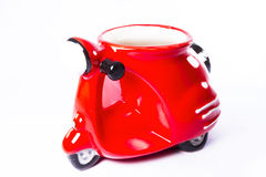 Ceramic red bike. Over white background Royalty Free Stock Photos