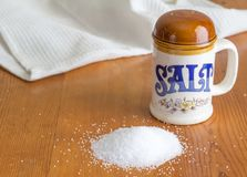 Ceramic retro salt shaker on rustic wooden kitchen table with he royalty free stock image