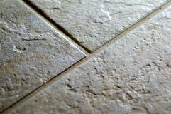 Ceramic rock tile flooring closeup. Indoor Royalty Free Stock Image