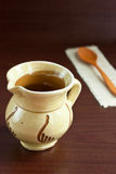 Ceramic rustic cup and spoon Stock Images