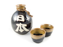 Ceramic Sake Bottle and Cups Stock Photo