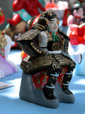 Ceramic samurai. A ceramic samurai figurine.As background is a market stall environment Stock Photography