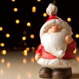 Ceramic Santa Claus on a bokeh background stock photos