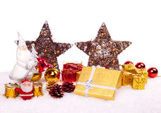 Ceramic santa with xmas ornaments. Cute ceramic santa with xmas ornaments on snow Stock Images