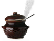 Ceramic saucepan with steam Stock Photography