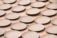 Ceramic saucers drying in the sun Royalty Free Stock Image