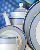 Ceramic set. Composition ceramic plates on a blue background Royalty Free Stock Photos