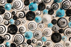 Ceramic in the shape of cones painted with figures of spirals. Texture of ceramic in the shape of cones painted with figures of spirals stock photography