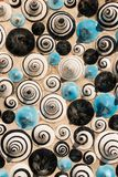 Ceramic in the shape of cones painted with figures of spirals. Texture of ceramic in the shape of cones painted with figures of spirals stock images