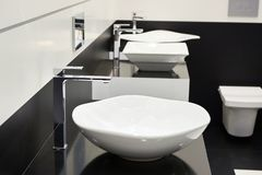 Ceramic sink with faucets. In public toilet Royalty Free Stock Photo