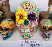 Ceramic skulls of various sizes stock photo