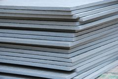 Ceramic Slabs. A pile stack of ceramic slab materials at a work site Royalty Free Stock Photography