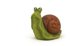 Ceramic snail. Ceramic figure of snail isolated on white background Royalty Free Stock Images