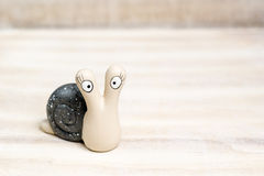 Ceramic snail looking at you. On a tray Royalty Free Stock Photo