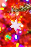 Ceramic snowflake on a branch Royalty Free Stock Images