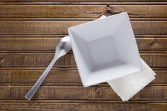 Ceramic soup square plate and spoon Royalty Free Stock Photo
