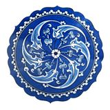 Ceramic souvenir plate with ornament. Ceramic souvenir plate with traditional turkish blue and white color painting on isolated white background stock photography