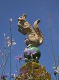 Ceramic Squirrel Atop a Gatepost Stock Photos