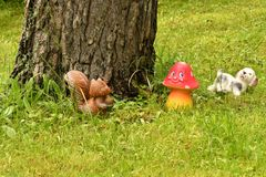 A ceramic squirrel in the garden. Stock Images