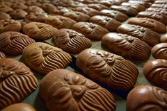 Ceramic face, cultural symbol of Vietnamese people. The ceramic symbols are mass-produced by hand to make souvenirs Stock Image
