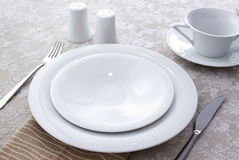 Ceramic tableware. On the table Stock Photography