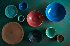 Ceramic tableware dishes plates on grungy royalty free stock image