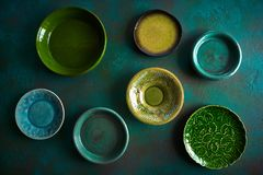 Ceramic tableware dishes plates on grungy stock photo