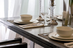 Ceramic tableware on the marble worktop Royalty Free Stock Photography