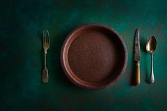 Ceramic tableware pottery plate on grungy royalty free stock image