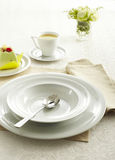 Ceramic tableware and Soupspoon Royalty Free Stock Image