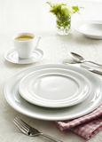 Ceramic tableware and Soupspoon Stock Image