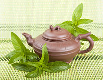 Ceramic tea and mint Stock Image