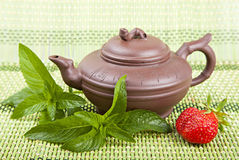 Ceramic tea, mint and strawberries Stock Photo