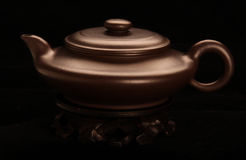 Ceramic tea-pot. Dull brown teapot Stock Image