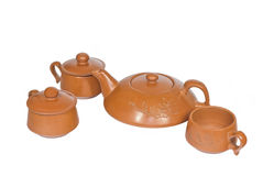 Ceramic tea set. Brown on a white background royalty free stock photography