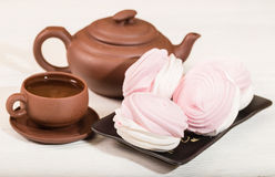 Ceramic teacup and pink zephyr Royalty Free Stock Images