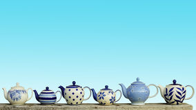 Ceramic teapot with blue pastel wall background. Royalty Free Stock Images