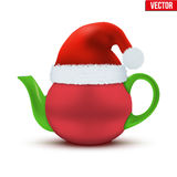 Ceramic teapot with Christmas hat of Santa Royalty Free Stock Images